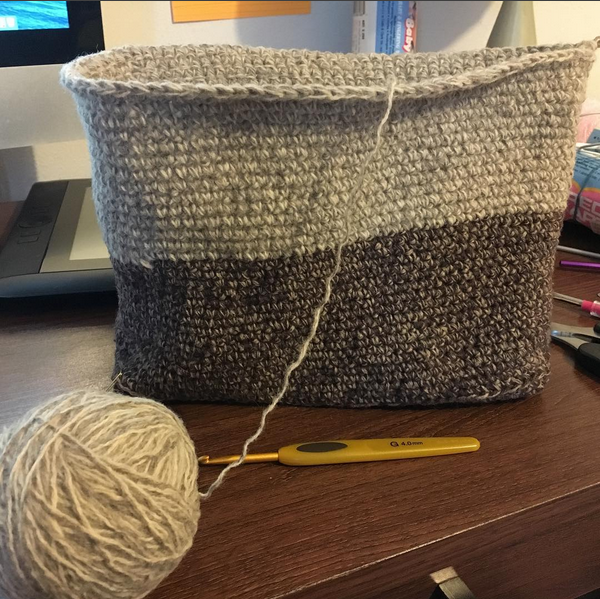 Working on a crochet bag made from unraveled thrift store sweaters.